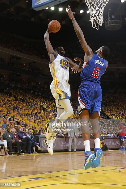 DeAndre Jordan of the Los Angeles Clippers blocks a dunk against Draymond Green of the Golden State Warriors in Game Three of the Western Conference...