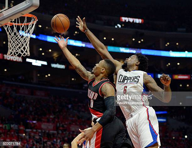 DeAndre Jordan of the Los Angeles Clippers blocks a layup by Damian Lillard of the Portland Trail Blazers during the first half in Game One of the...