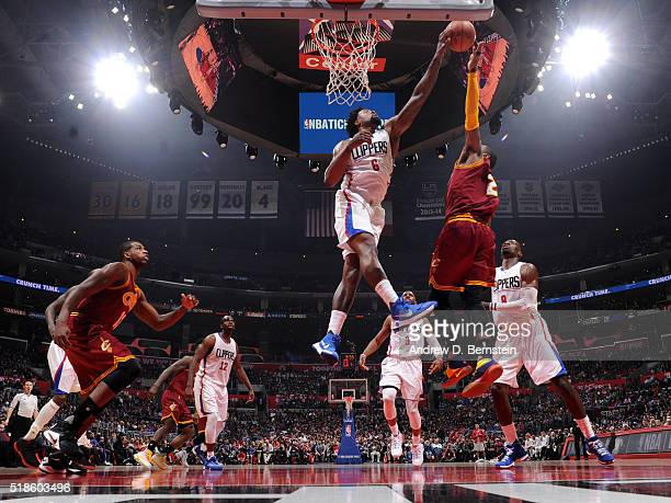 DeAndre Jordan of the Los Angeles Clippers blocks the shot of Kyrie Irving of the Cleveland Cavaliers during the game on March 13 2016 at STAPLES...