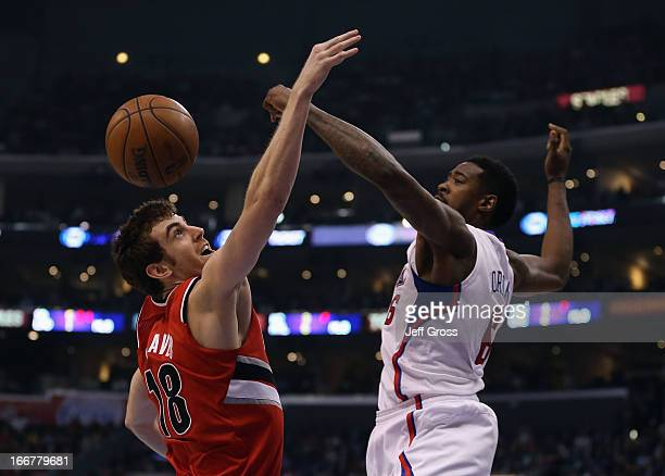 DeAndre Jordan of the Los Angeles Clippers blocks the shot of Victor Claver of the Portland Trail Blazers in the second quarter at Staples Center on...