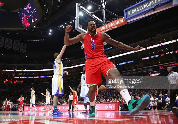 DeAndre Jordan of the Los Angeles Clippers celebrates after making a shot while being fouled in the second half during the NBA game against the...