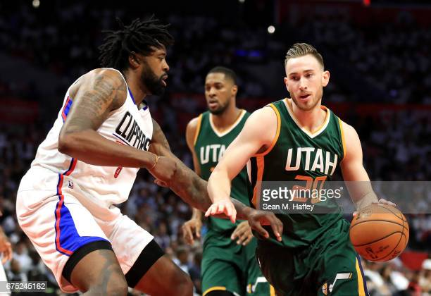 DeAndre Jordan of the Los Angeles Clippers defends against Gordon Hayward of the Utah Jazz during the second half of Game Seven of the Western...