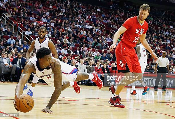 DeAndre Jordan of the Los Angeles Clippers dives for the basketball in front of Donatas Motiejunas of the Houston Rockets during their game at the...