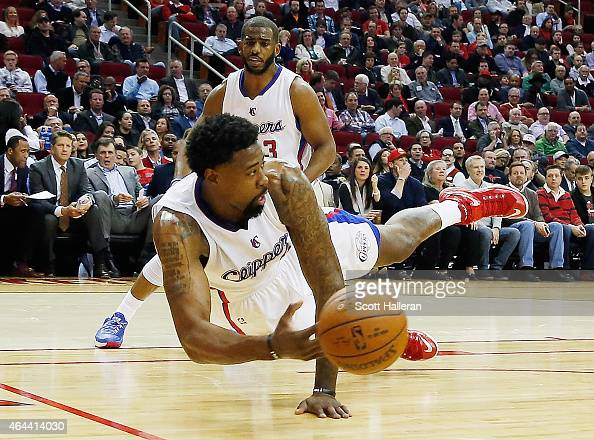 DeAndre Jordan of the Los Angeles Clippers dives for the basketball in front of teammate Chris Paul during their game against the Houston Rockets at...