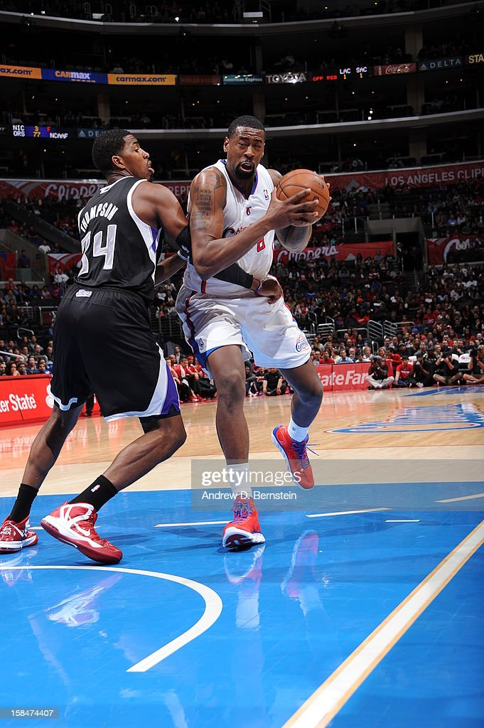 DeAndre Jordan #6 of the Los Angeles Clippers drives to the basket against Jason Thompson #34 of the Sacramento Kings at Staples Center on December 1, 2012 in Los Angeles, California.