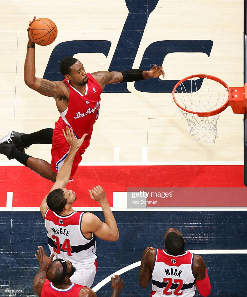 <a gi-track='captionPersonalityLinkClicked' href=/galleries/search?phrase=DeAndre+Jordan&family=editorial&specificpeople=4665718 ng-click='$event.stopPropagation()'>DeAndre Jordan</a> #6 of the Los Angeles Clippers dunks against <a gi-track='captionPersonalityLinkClicked' href=/galleries/search?phrase=JaVale+McGee&family=editorial&specificpeople=4195625 ng-click='$event.stopPropagation()'>JaVale McGee</a> #34 of the Washington Wizards during the game at the Verizon Center on February 4, 2012 in Washington, DC.