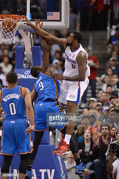 DeAndre Jordan of the Los Angeles Clippers dunks against the Oklahoma City Thunder at Staples Center on April 9 2014 in Los Angeles California NOTE...