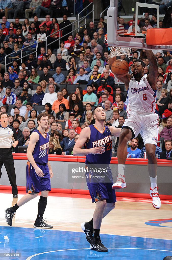 <a gi-track='captionPersonalityLinkClicked' href=/galleries/search?phrase=DeAndre+Jordan&family=editorial&specificpeople=4665718 ng-click='$event.stopPropagation()'>DeAndre Jordan</a> #6 of the Los Angeles Clippers dunks during a game against the Phoenix Suns at STAPLES Center on December 30, 2013 in Los Angeles, California.