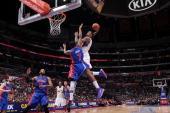 DeAndre Jordan of the Los Angeles Clippers dunks on an alleyoop pass from teammate Chris Paul against Brandon Knight of the Detroit Pistons at...