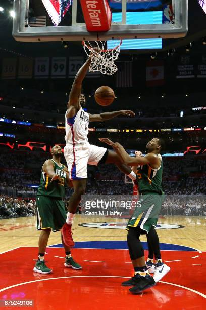 DeAndre Jordan of the Los Angeles Clippers dunks over Boris Diaw and Rodney Hood of the Utah Jazz during the first half of Game Seven of the Western...