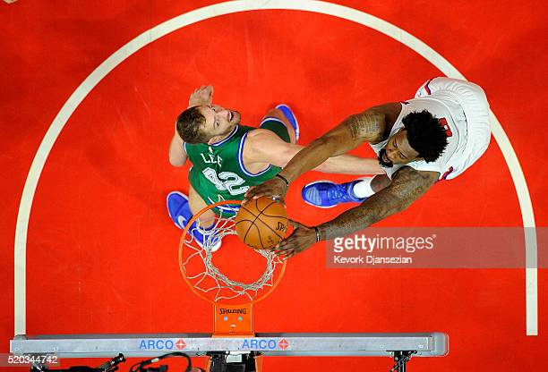 DeAndre Jordan of the Los Angeles Clippers dunks over David Lee of the Dallas Mavericks during the first half of the basketball game at Staples...