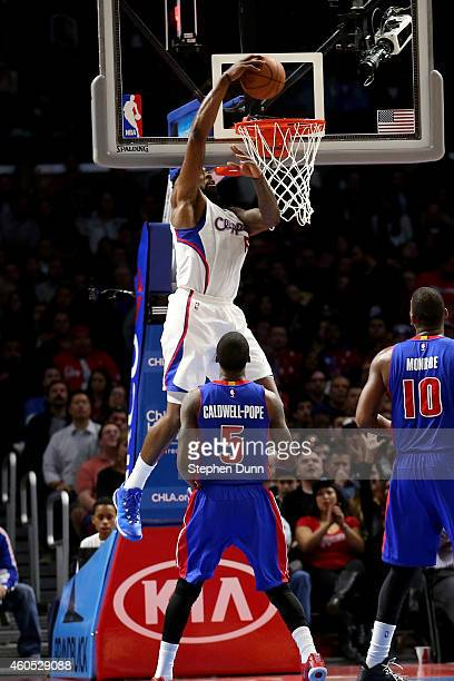 DeAndre Jordan of the Los Angeles Clippers dunks over Kentavious Caldwell Pope of the Detroit Pistons at Staples Center on December 15 2014 in Los...