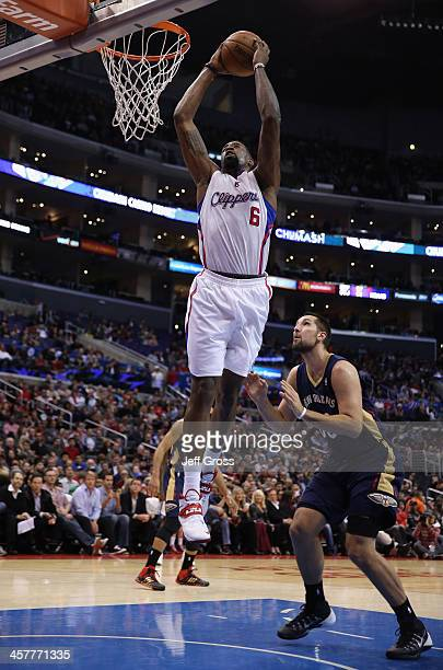 DeAndre Jordan of the Los Angeles Clippers dunks over Ryan Anderson of the New Orleans Pelicans in the first half at Staples Center on December 18...