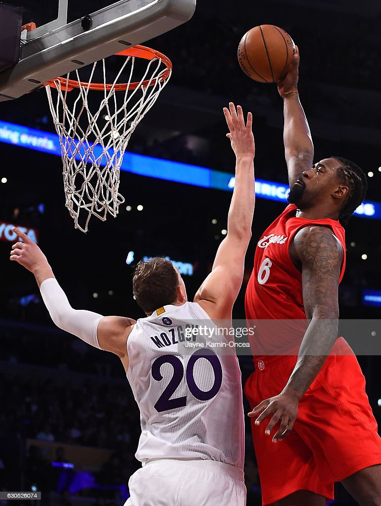 DeAndre Jordan #6 of the Los Angeles Clippers dunks over Timofey Mozgov #20 of the Los Angeles Lakers for the first basket of the game at Staples Center on December 25, 2016 in Los Angeles, California.