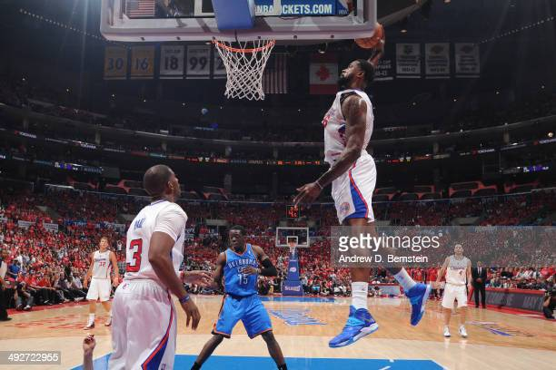 DeAndre Jordan of the Los Angeles Clippers dunks the ball against the Oklahoma City Thunder in Game Six of the Western Conference Semifinals during...
