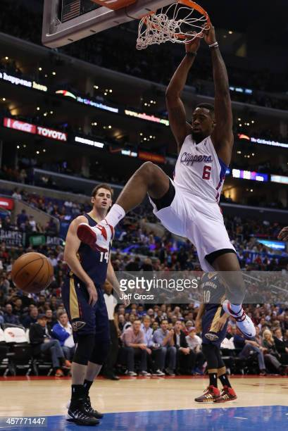 DeAndre Jordan of the Los Angeles Clippers dunks the ball as Jason Smith of the New Orleans Pelicans looks on in the first half at Staples Center on...
