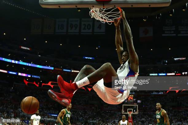 DeAndre Jordan of the Los Angeles Clippers dunks the ball during the first half of Game Seven of the Western Conference Quarterfinals against the...