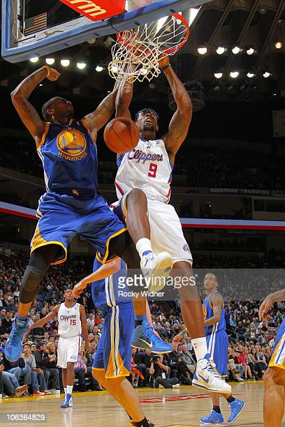 DeAndre Jordan of the Los Angeles Clippers dunks the ball over Dorell Wright of the Golden State Warriors on October 29 2010 at Oracle Arena in...