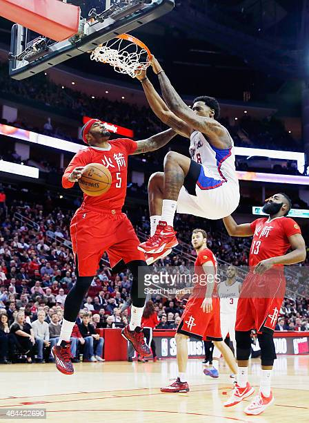 DeAndre Jordan of the Los Angeles Clippers dunks the basketball over Josh Smith of the Houston Rockets during their game at the Toyota Center on...