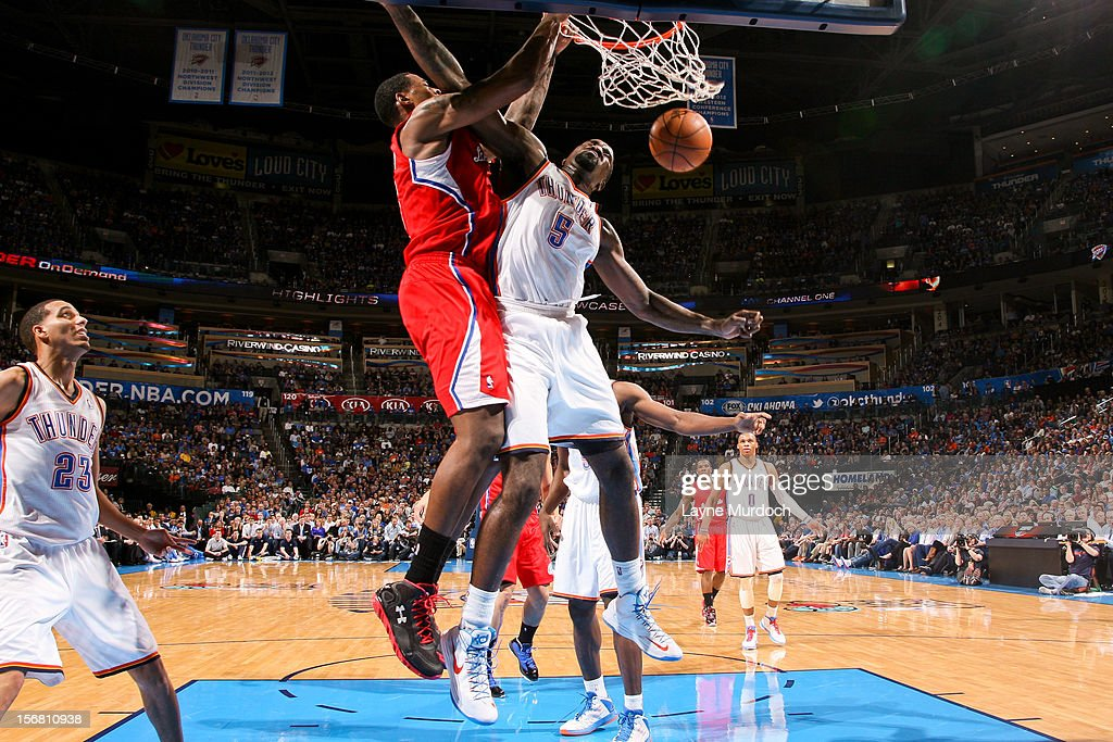 DeAndre Jordan #6 of the Los Angeles Clippers follows through on a dunk against Kendrick Perkins #5 of the Oklahoma City Thunder on November 21, 2012 at the Chesapeake Energy Arena in Oklahoma City, Oklahoma.