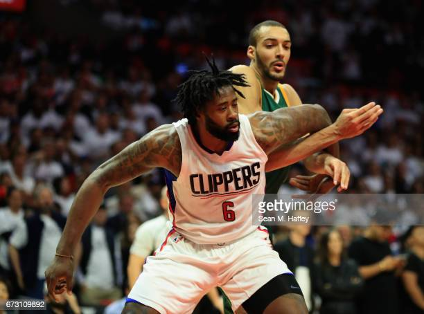 DeAndre Jordan of the Los Angeles Clippers gains position on Rudy Gobert of the Utah Jazz during the second half of Game Five of the Western...
