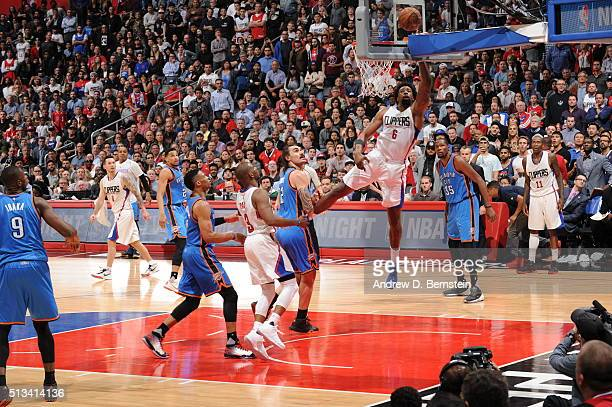 DeAndre Jordan of the Los Angeles Clippers goes for the dunk against the Oklahoma City Thunder during the game on March 2 2016 at STAPLES Center in...