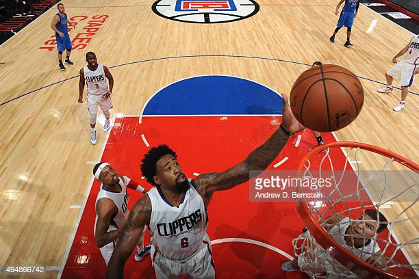 DeAndre Jordan of the Los Angeles Clippers goes for the layup against the Dallas Mavericks during the game on October 29 2015 at STAPLES Center in...