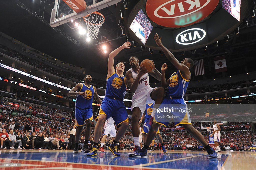 DeAndre Jordan #6 of the Los Angeles Clippers goes to the basket against Harrison Barnes #40 and David Lee #10 of the Golden State Warriors during the game between the Los Angeles Clippers and the Golden State Warriors at Staples Center on November 3, 2012 in Los Angeles, California.
