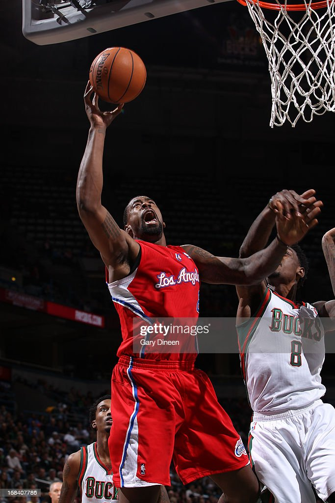 DeAndre Jordan #6 of the Los Angeles Clippers goes to the basket against Larry Sanders #8 of the Milwaukee Bucks during the game on December 15, 2012 at the BMO Harris Bradley Center in Milwaukee, Wisconsin.