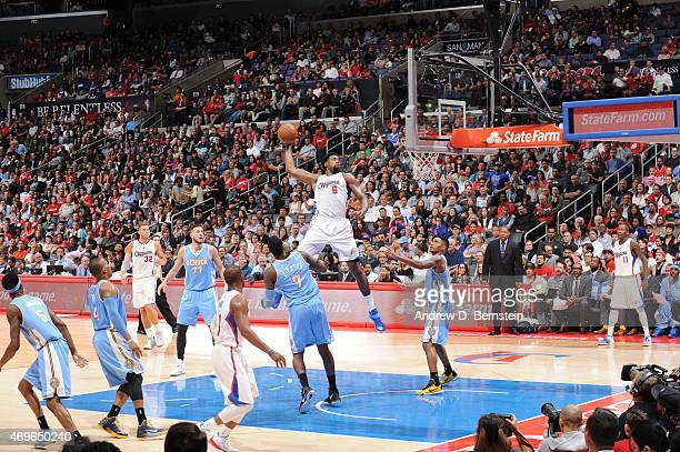 DeAndre Jordan of the Los Angeles Clippers goes up for a dunk against the Denver Nuggets on April 13 2015 at STAPLES Center in Los Angeles California...