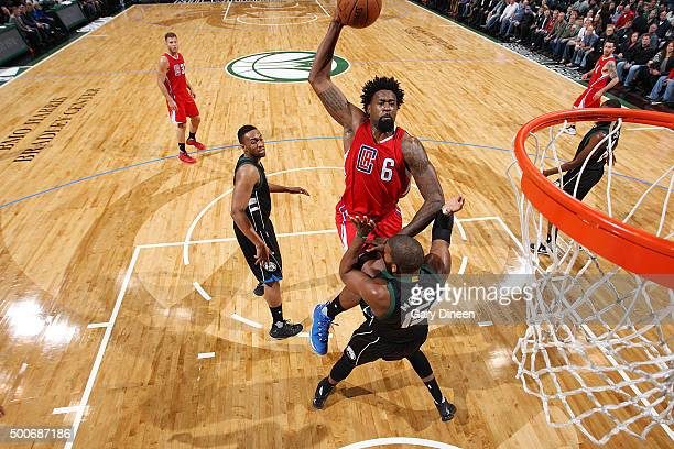 DeAndre Jordan of the Los Angeles Clippers goes up for a dunk against Greg Monroe of the Milwaukee Bucks on December 9 2015 at the BMO Harris Bradley...
