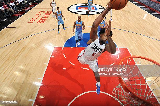 DeAndre Jordan of the Los Angeles Clippers goes up for a dunk against the Denver Nuggets on March 27 2016 at STAPLES Center in Los Angeles California...