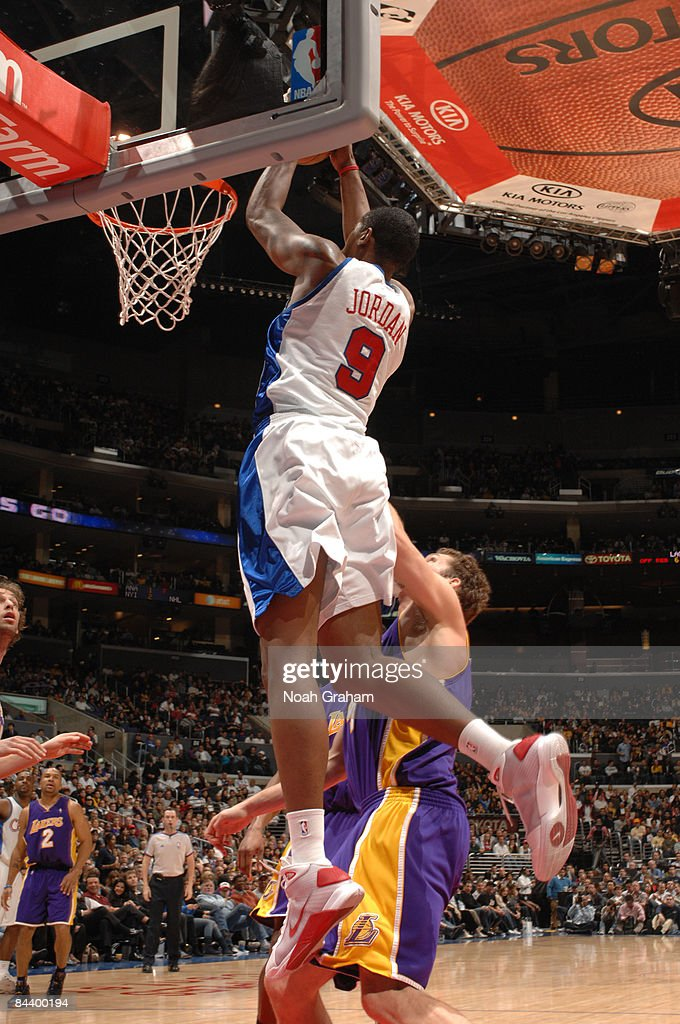 DeAndre Jordan #9 of the Los Angeles Clippers goes up for a dunk over Luke Walton #4 of the Los Angeles Lakers at Staples Center on January 21, 2009 in Los Angeles, California.