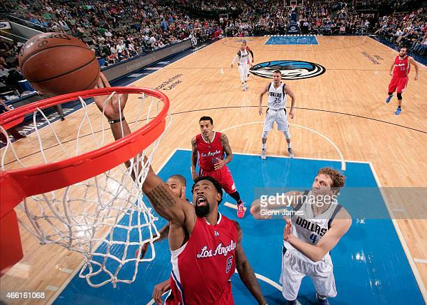 DeAndre Jordan of the Los Angeles Clippers goes up for a rebound against the Dallas Mavericks on March 13 2015 at the American Airlines Center in...