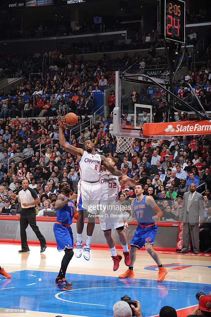 <a gi-track='captionPersonalityLinkClicked' href=/galleries/search?phrase=DeAndre+Jordan&family=editorial&specificpeople=4665718 ng-click='$event.stopPropagation()'>DeAndre Jordan</a> #6 of the Los Angeles Clippers grabbing a rebound over <a gi-track='captionPersonalityLinkClicked' href=/galleries/search?phrase=Amar%27e+Stoudemire&family=editorial&specificpeople=201492 ng-click='$event.stopPropagation()'>Amar'e Stoudemire</a> #1 <a gi-track='captionPersonalityLinkClicked' href=/galleries/search?phrase=Andrea+Bargnani&family=editorial&specificpeople=533014 ng-click='$event.stopPropagation()'>Andrea Bargnani</a> #77 of the New York Knicks and <a gi-track='captionPersonalityLinkClicked' href=/galleries/search?phrase=Blake+Griffin+-+Basketball+Player&family=editorial&specificpeople=4216010 ng-click='$event.stopPropagation()'>Blake Griffin</a> #32 of the Los Angeles Clippers in a game against the New York Knicks at Staples Center on November 27, 2013 in Los Angeles, California.