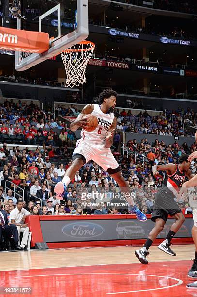 DeAndre Jordan of the Los Angeles Clippers grabs the rebound against the Portland Trail Blazers during a preseason game on October 22 2015 at STAPLES...