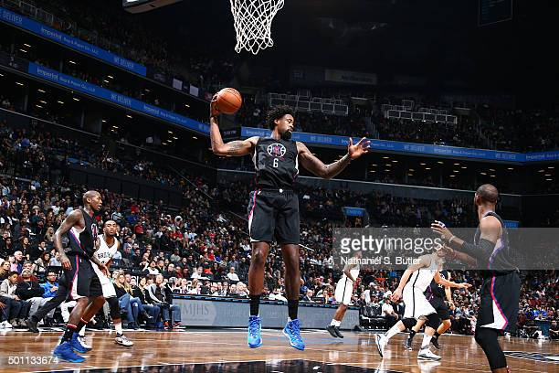 DeAndre Jordan of the Los Angeles Clippers grabs the rebound against the Brooklyn Nets on December 12 2015 at Barclays Center in Brooklyn New York...
