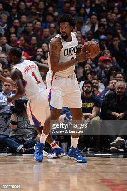 DeAndre Jordan of the Los Angeles Clippers handles the ball against the Oklahoma City Thunder on December 21 2015 at STAPLES Center in Los Angeles...