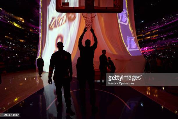 DeAndre Jordan of the Los Angeles Clippers hangs from the net during Los Angeles Lakers pregame player introductions at Staples Center March 21 in...