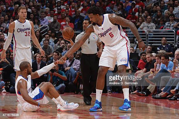 DeAndre Jordan of the Los Angeles Clippers helps up Chris Paul during a game against the San Antonio Spurs in Game Five of the Western Conference...
