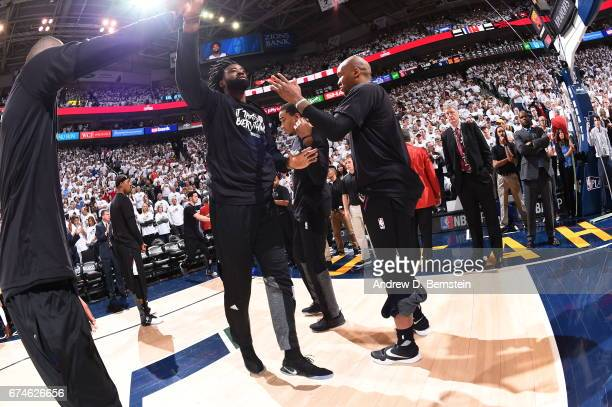 DeAndre Jordan of the Los Angeles Clippers high fives his teammates before the game against the Utah Jazz during Game Six of the Western Conference...