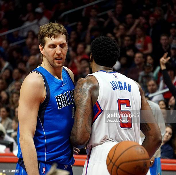 DeAndre Jordan of the Los Angeles Clippers in action against Dirk Nowitzki of Mavericks during the NBA game between Dallas Mavericks and Los Angeles...