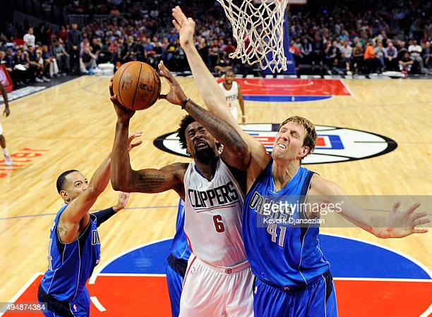 DeAndre Jordan of the Los Angeles Clippers is fouled by Dirk Nowitzki of the Dallas Mavericks during the second quarter of the basketball game...