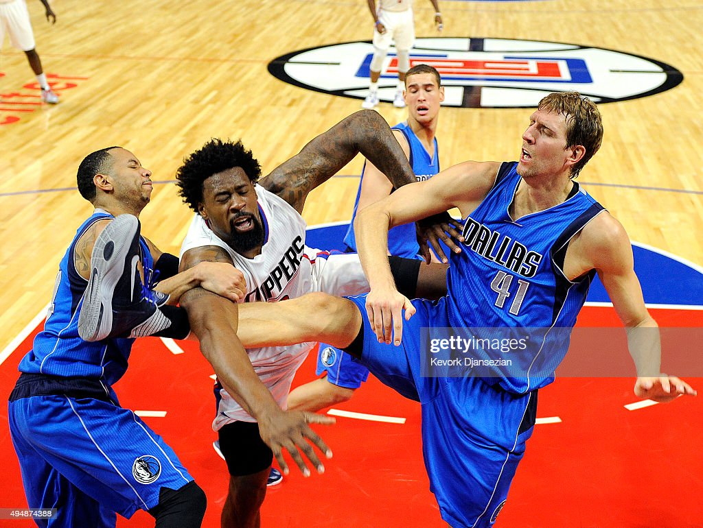 <a gi-track='captionPersonalityLinkClicked' href=/galleries/search?phrase=DeAndre+Jordan&family=editorial&specificpeople=4665718 ng-click='$event.stopPropagation()'>DeAndre Jordan</a> #6 of the Los Angeles Clippers is fouled by <a gi-track='captionPersonalityLinkClicked' href=/galleries/search?phrase=Dirk+Nowitzki&family=editorial&specificpeople=201490 ng-click='$event.stopPropagation()'>Dirk Nowitzki</a> #41 and <a gi-track='captionPersonalityLinkClicked' href=/galleries/search?phrase=Devin+Harris&family=editorial&specificpeople=202195 ng-click='$event.stopPropagation()'>Devin Harris</a> of the Dallas Mavericks during the second quarter of the basketball game Staples Center October 29, 2015, in Los Angeles California.