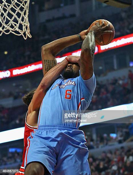 DeAndre Jordan of the Los Angeles Clippers is fouled by Joakim Noah of the Chicago Bulls at the United Center on March 1 2015 in Chicago Illinois...