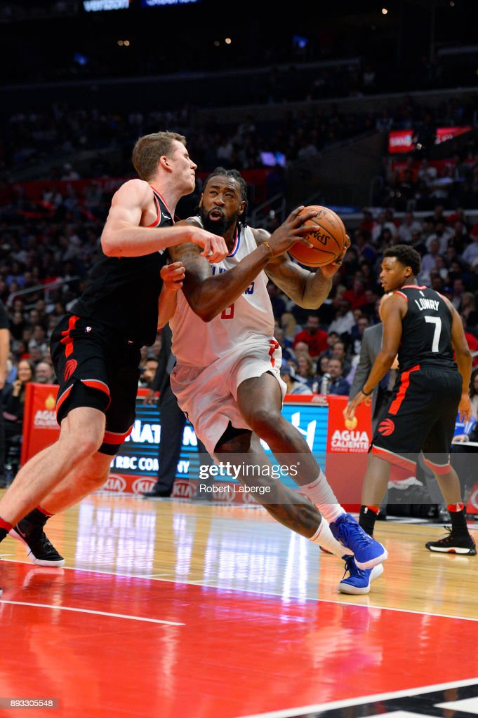 DeAndre Jordan #6 of the Los Angeles Clippers plays against Jakob Poeltl #42 of the Toronto Raptors on December 11, 2017 at STAPLES Center in Los Angeles, California.