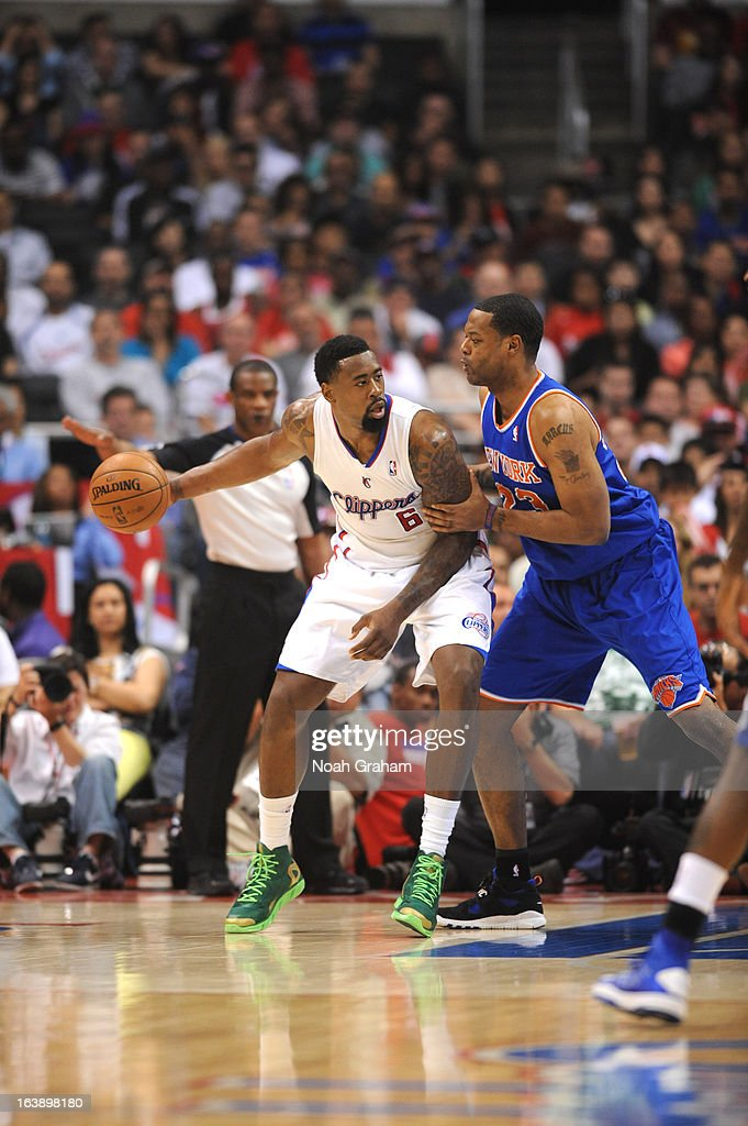 DeAndre Jordan #6 of the Los Angeles Clippers protects the ball from Marcus Camby #23 of the New York Knicks during the game between the Los Angeles Clippers and the New York Knicks at Staples Center on March 17, 2013 in Los Angeles, California.