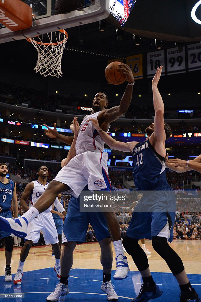 <a gi-track='captionPersonalityLinkClicked' href=/galleries/search?phrase=DeAndre+Jordan&family=editorial&specificpeople=4665718 ng-click='$event.stopPropagation()'>DeAndre Jordan</a> #6 of the Los Angeles Clippers pulls down a rebound against the Minnesota Timberwolves at Staples Center on November 11, 2013 in Los Angeles, California.