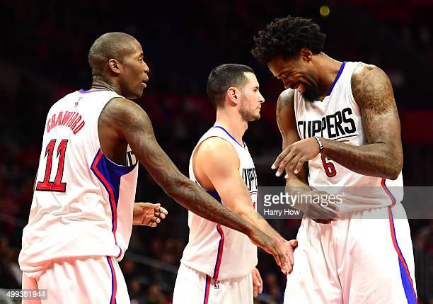 DeAndre Jordan of the Los Angeles Clippers reacts after making a free throw as Jamal Crawford and JJ Redick give him a pat during a 10287 Clipper win...