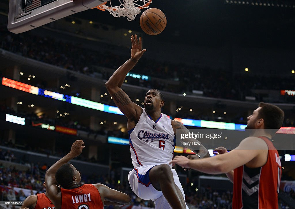 <a gi-track='captionPersonalityLinkClicked' href=/galleries/search?phrase=DeAndre+Jordan&family=editorial&specificpeople=4665718 ng-click='$event.stopPropagation()'>DeAndre Jordan</a> #6 of the Los Angeles Clippers reacts to his dunk in front of <a gi-track='captionPersonalityLinkClicked' href=/galleries/search?phrase=Linas+Kleiza&family=editorial&specificpeople=211014 ng-click='$event.stopPropagation()'>Linas Kleiza</a> #11 and <a gi-track='captionPersonalityLinkClicked' href=/galleries/search?phrase=Kyle+Lowry&family=editorial&specificpeople=714625 ng-click='$event.stopPropagation()'>Kyle Lowry</a> #3 of the Toronto Raptors during a 102-83 Clipper win at Staples Center on December 9, 2012 in Los Angeles, California.